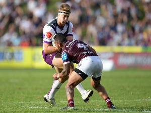 CHRISTIAN WELCH of the Storm is tackled during the NRL match between the Manly Sea Eagles and the Melbourne Storm at Lottoland in Sydney, Australia.