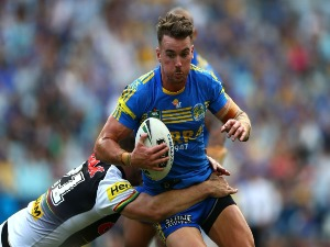 CLINT GUTHERSON of the Eels is tackled during the NRL match between the Parramatta Eels and the Penrith Panthers at ANZ Stadium in Sydney, Australia.