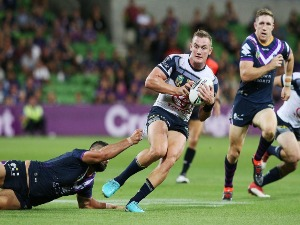 Jesse Bromwich of the Storm tackles COEN HESS of the Cowboys during the NRL match between the Melbourne Storm and the North Queensland Cowboys at AAMI Park in Melbourne, Australia.