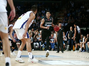 COREY WEBSTER of the Breakers brings the ball up court during the NBL match between the New Zealand Breakers and the Brisbane Bullets at Vector Arena in Auckland, New Zealand.