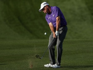CRAIG HOCKNULL of Australia chips onto the second green during the Waste Management Phoenix Open at TPC Scottsdale in Scottsdale, Arizona.