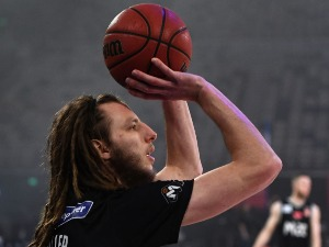 CRAIG MOLLER of United warms up during the NBL match between Melbourne United and the Cairns Taipans at Hisense Arena in Melbourne, Australia.
