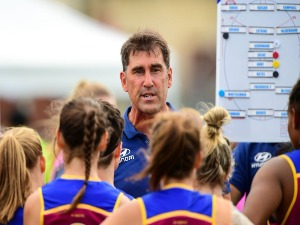 CRAIG STARCEVICH, coach of the Lions addresses the team at quarter time during the 2017 AFLW match between the Fremantle Dockers and the Brisbane Lions at Fremantle Oval in Perth, Australia.