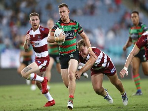 DAMIEN COOK of the Rabbitohs makes a break during the NRL trial match between the South Sydney Rabbitohs and Wigan at ANZ Stadium Sydney in Sydney, Australia.