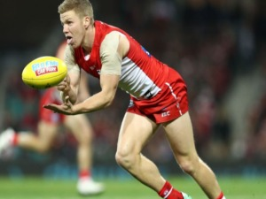 DAN HANNEBERY of the Swans handballs during the AFL match between the Sydney Swans and the Essendon Bombers at SCG in Sydney, Australia.