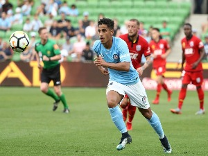 DANIEL ARZANI of the City runs with the ball during the A-League match between Melbourne City and Adelaide United at AAMI Park in Melbourne, Australia.