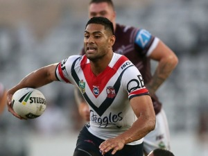 DANIEL TUPOU of the Roosters runs the ball during the NRL Trial match between the Manly Warringah Sea Eagles and Sydney Roosters at Central Coast Stadium in Gosford, Australia.