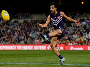 DANYLE PEARCE of the Dockers kicks the ball during the AFL match between the Fremantle Dockers and the Gold Coast Suns at Domain Stadium in Perth, Australia.