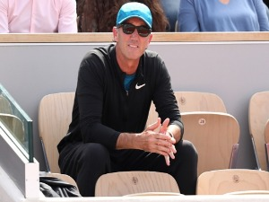 DARREN CAHILL, coach of Simona Halep of Romania watches her face Angelique Kerber of Germany in the ladies singles quarter finals match during day eleven of the 2018 French Open at Roland Garros in Paris, France.