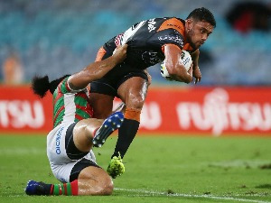 DAVID NFOALUMA of the Tigers is tackled by Siosifa Talakai of the Rabbitohs during the round one NRL match between the South Sydney Rabbitohs and the Wests Tigers at ANZ Stadium in Sydney, Australia.