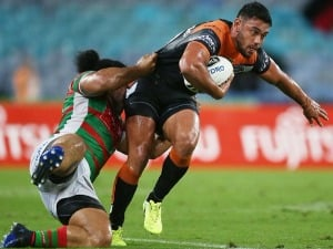 DAVID NOFOALUMA of the Tigers is tackled by Siosifa Talakai of the Rabbitohs during the NRL match between the South Sydney Rabbitohs and the Wests Tigers at ANZ Stadium in Sydney, Australia.
