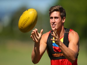 DAVID SWALLOW catches a ball during a Gold Coast Suns AFL training session at Metricon Stadium in Gold Coast, Australia.