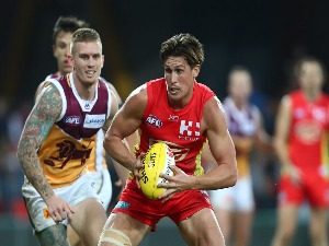 DAVID SWALLOW of the Suns in action during AFL match between the Gold Coast Suns and Brisbane Lions at Metricon Stadium in Gold Coast, Australia.