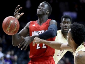 DENG ADEL #22 of the Louisville Cardinals loses the ball during the ACC Men's Basketball Tournament at BC in New York City.