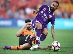 DIEGO CASTRO of the Roar and JOSEPH KATEBIAN of the Glory compete for the ball during the A-League match between the Brisbane Roar and Perth Glory at Suncorp Stadium in Brisbane, Australia.