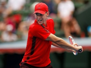 DOMINIC THIEM of Austria plays a backhand against Novak Djokovic of Serbia in the 2018 Kooyong Classic at Kooyong in Melbourne, Australia.