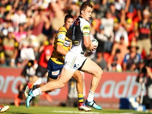 DYLAN EDWARDS of the Panthers makes a break during the NRL match between the Penrith Panthers and the Parramatta Eels at Panthers Stadium in Sydney, Australia.