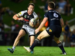DYLAN EDWARDS of the Panthers looks to get past Michael Morgan of the Cowboys during the NRL match between the North Queensland Cowboys and the Penrith Panthers at 1300SMILES Stadium in Townsville, Australia.