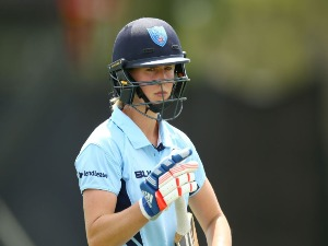 ELLYSE PERRY of NSW leaves the field after being dismissed during the WNCL Final match between New South Wales and Western Australia at Blacktown International Sportspark in Sydney, Australia.