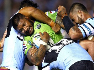 FRANK PAUL NUUAUSALA of the Raiders is tackled by Tinirau Arona, Andrew Fifita and Wade Graham of the Sharks during the NRL match between the Cronulla Sharks and the Canberra Raiders at Remondis Stadium in Sydney, Australia.