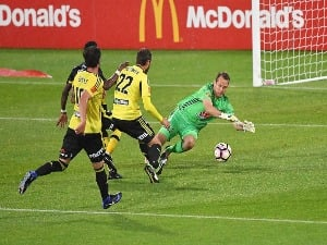 GLEN MOSS of the Wellington Phoenix defends during the A-League match between the Wellington Phoenix and the Central Coast Mariners at Westpac Stadium in Wellington, New Zealand.