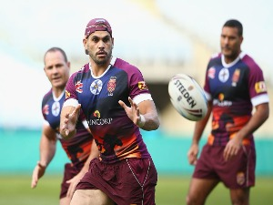 GREG INGLIS catches a pass during a Queensland Maroons State of Origin training session at ANZ Stadium in Sydney, Australia.