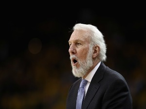 Head coach GREGG POPOVICH of the San Antonio Spurs shouts to his team during their game against the Golden State Warriors in Game 2 of Round 1 of the 2018 NBA Playoffs at ORACLE Arena in Oakland, California.