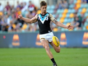 HAMISH HARTLETT of the Power in action during the AFL match between the Brisbane Lions and the Port Adelaide Power at The Gabba in Brisbane, Australia.