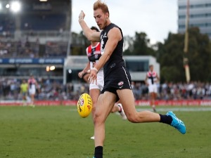 HARRY MCKAY of the Blues kicks the ball during the AFL JLT Community Series match between the Carlton Blues and the St Kilda Saints at Ikon Park in Melbourne, Australia.