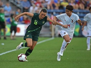 HAYLEY RASO Australia holds off Narumi Miura of Japan during the Tournament Of Nations at Toyota Park in Bridgeview, Illinois.