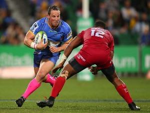 HEATH TESSMANN of the Force looks to avoid being tackled by Samu Kerevi of the Reds during the Super Rugby match between the Western Force and the Queensland Reds at nib Stadium in Perth, Australia.
