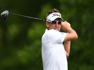 IAN POULTER of England hits his tee shot on the second hole during the final round of the Houston Open at the Golf Club of Houston in Humble, Texas.