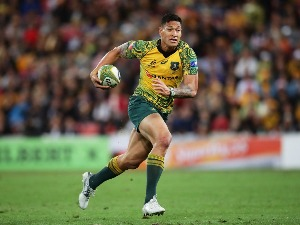 ISRAEL FOLAU of the Wallabies runs with the ball during the Bledisloe Cup match at Suncorp Stadium in Brisbane, Australia.