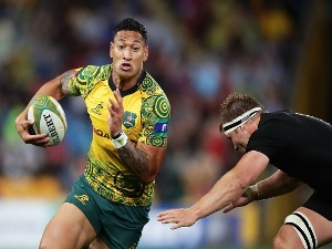 ISRAEL FOLAU of the Wallabies takes on the defence during the Bledisloe Cup match between the Australian Wallabies and the New Zealand All Blacks at Suncorp Stadium in Brisbane, Australia.