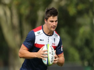 JACK MADDOCKS of the Rebels runs with the ball during a Melbourne Rebels Super Rugby training session at Gosch's Paddock in Melbourne, Australia.