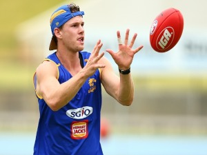 JACK REDDEN marks the ball during a West Coast Eagles AFL pre-season training session at the WA Athletics Stadium in Perth, Australia.