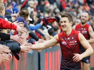 JACK TRENGOVE of the Demons celebrates the win with fans during the AFL match between the Melbourne Demons and the Port Adelaide Power at MCG in Melbourne, Australia.