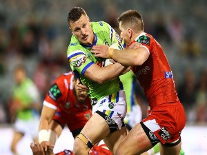 JACK WIGHTON of the Raiders is tackled during the NRL match between the Canberra Raiders and the St George Illawarra Dragons at GIO Stadium in Canberra, Australia.