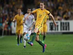 JACKSON IRVINE of the Socceroos controls the ball during the FIFA World Cup Qualifier match between the Australian Socceroos and United Arab Emirates at Allianz Stadium in Sydney, Australia.