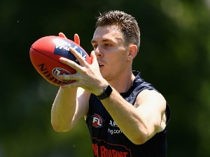 JAKE LEVER of the Demons marks during a Melbourne Demons AFL pre-season training session at Gosch's Paddock in Melbourne, Australia.