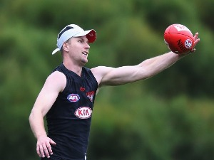 JAKE STRINGER marks the ball during an Essendon Bombers AFL training session at the Essendon Bombers Football Club in Melbourne, Australia.