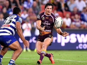 JAMES ROBERTS of the Broncos passes the ball during the NRL match between the Brisbane Broncos and the Canterbury Bulldogs at Suncorp Stadium in Brisbane, Australia.