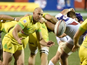 JAMES STANNARD of Australia passes the ball against the United States during the USA Sevens Rugby tournament at Sam Boyd Stadium in Las Vegas, Nevada.