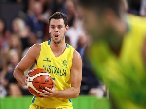 JASON CADEE of Australia looks for support during the Preliminary Basketball round match between Australia and Nigeria of the Gold Coast 2018 Commonwealth Games in the Cairns, Australia.