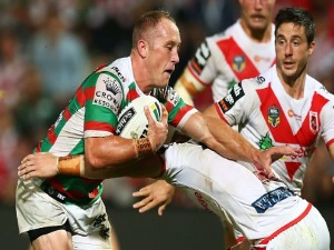 JASON CLARK of the Rabbitohs is tackled during the NRL match between the St George Illawarra Dragons and the South Sydney Rabbitohs at UOW Jubilee Oval in Sydney, Australia.