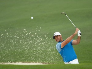 JASON DAY of Australia plays a shot from a bunker on the second hole during the 2018 Masters Tournament at Augusta National Golf Club in Augusta, Georgia.