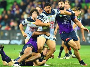 JASON TAUMALOLO of the Cowboys is tackled during a NRL match between the Melbourne Storm and the North Queensland Cowboys at AAMI Park in Melbourne, Australia.