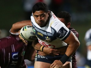 JASON TAUMALOLO of the Cowboys is tackled during the NRL match between the Manly Sea Eagles and the North Queensland Cowboys at Lottoland in Sydney, Australia.