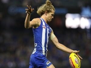 JED ANDERSON of the Kangaroos in action during the AFL match between the North Melbourne Kangaroos and Port Adelaide Power at Etihad Stadium in Melbourne, Australia.