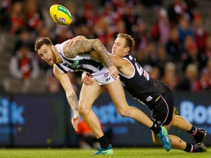 David Armitage of the Saints tackles JEREMY HOWE of the Magpies during the AFL match between the St Kilda Saints and the Collingwood Magpies at Etihad Stadium in Melbourne, Australia.
